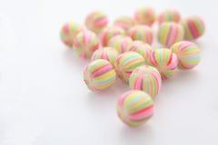 белизна конфеты предпосылки цветастая Стоковые Фотографии RF