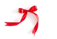 белизна красной тесемки предпосылки глянцеватая стоковое фото