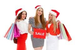 белизна покупкы сбывания девушки рождества предпосылки счастливая Стоковое Фото