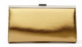 белизна портмона золота предпосылки Стоковое фото RF