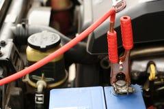 белизна предмета заряжателя батареи предпосылки изолированная Стоковое Фото