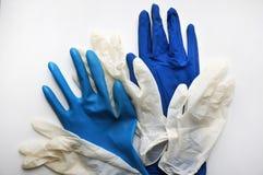 белизна предпосылки изолированная перчатками резиновая Стоковое Изображение RF