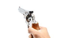 белизна руки пушки предпосылки изолированная удерживанием Стоковые Изображения