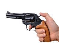 белизна руки пушки предпосылки изолированная удерживанием Стоковые Фотографии RF