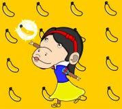Белизна снега обезьяны получает специальный банан Стоковые Изображения