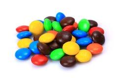 белизна шоколада конфеты предпосылки изолированная взрезом Стоковые Фотографии RF