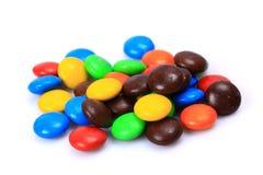 белизна шоколада конфеты предпосылки изолированная взрезом Стоковые Изображения