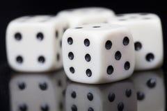 Белизна 4 dices в черной предпосылке Стоковая Фотография