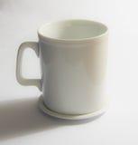 Белое стекло в белой предпосылке Стоковые Изображения RF