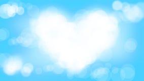 Белое bokeh сердца на свете - голубой предпосылке нерезкости Стоковое Изображение