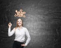 Белокурая девушка и ее крона Стоковая Фотография