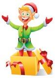 Белокурый эльф рождества хлопающ из изолированного настоящего момента коробки Стоковая Фотография