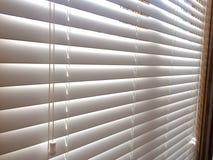 Белые деревянные шторки окна Стоковое фото RF