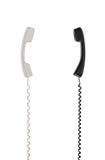Белые и черные телефонные трубки аранжированы вертикально к одину другого Стоковое Изображение RF