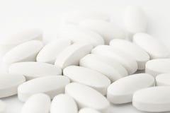 Белые таблетки Стоковые Фото