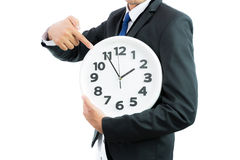 Белые часы держа в руках бизнесмена изолированными Стоковая Фотография RF