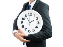Белые часы держа в руках бизнесмена изолированными Стоковое Изображение RF