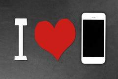 Белые smartphones лежа на темной поверхности Стоковые Фото