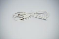 Белый заряжатель кабеля USB Стоковое фото RF