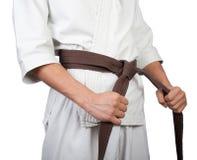 Белый край пояса кимоно в руках Стоковая Фотография