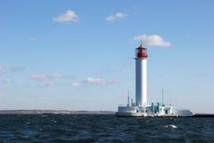 Белый маяк в море Стоковое Изображение