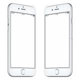 Белый модель-макет smartphone немножко повернул обе стороны стоковая фотография
