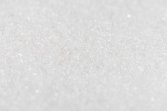 Белый органический тростниковый сахар против предпосылки Селективный фокус Стоковая Фотография