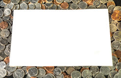 Белый текстовый участок на предпосылке монеток США Стоковое Фото
