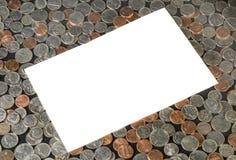 Белый текстовый участок на предпосылке монеток США Стоковое фото RF