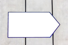 Белый указатель для текста на стене Стоковое фото RF