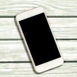 Белый smartphone с черным экраном на белой предпосылке тимберса Стоковое Изображение RF
