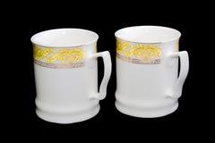2 белых чашки на черной предпосылке Стоковые Изображения RF