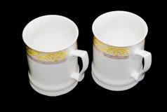 2 белых чашки на черной предпосылке Стоковые Изображения