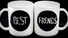 2 белых чашки с надписью Стоковые Изображения