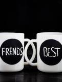 2 белых чашки с надписью Стоковое Изображение RF