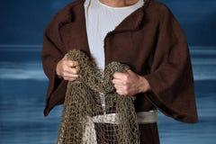 Библейский рыболов держа сети Стоковое фото RF