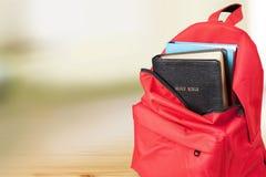 Библия в рюкзаке Стоковая Фотография RF