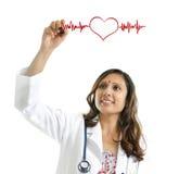 биение сердца чертежа доктора стоковое фото rf