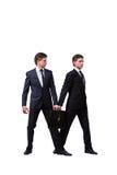 2 бизнесмена близнецов споря друг с другом изолированный на белизне Стоковая Фотография RF