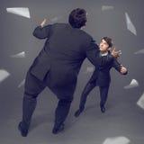 2 бизнесмена воюя как sumoist Стоковое Изображение