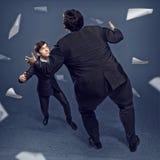 2 бизнесмена воюя как sumoist Стоковые Фото