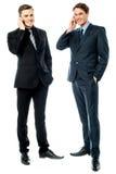 2 бизнесмена говоря на мобильном телефоне Стоковые Изображения