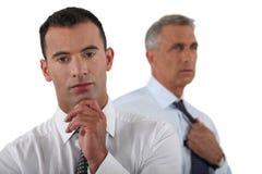 2 бизнесмена подготавливая представление Стоковое фото RF
