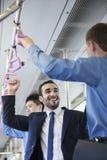2 бизнесмена стоя и говоря на метро Стоковые Фотографии RF