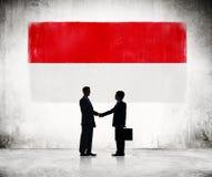 2 бизнесмена с флагом Indonesien Стоковые Изображения RF