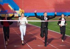 Бизнесмены бежать на гоночном треке Стоковое фото RF