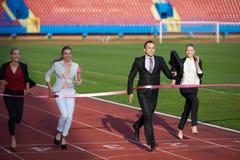 Бизнесмены бежать на гоночном треке Стоковая Фотография RF