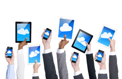 Бизнесмены вручают держать коммуникационные устройства Стоковое Изображение