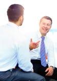 Бизнесмены встречая в современном офисе Стоковое Изображение RF