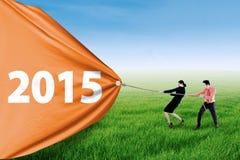 Бизнесмены вытягивая номер 2015 Стоковая Фотография RF